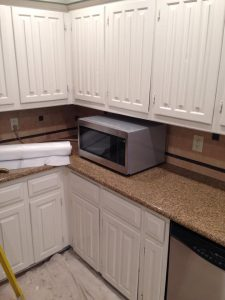 before kitchen counter and cabinets