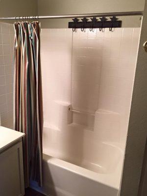 Before vinyl tub in a bathroom